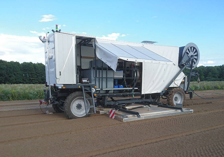 Fully automatic steam machine in test operation for open land application in northern Germany